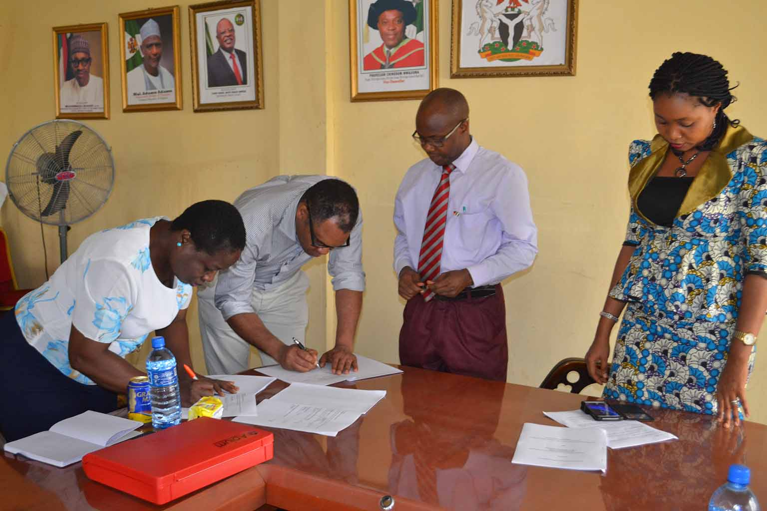 Signing of Memorandum of Understanding between the University and Prof Brando Okolo. Left to right Prof G.M.T Emezue, Prof Brando Okolo, Prof Jonny Ogunji (the Director of Academic Programme) and Barrister Ogochukwu (Head of the University Legal Unit)