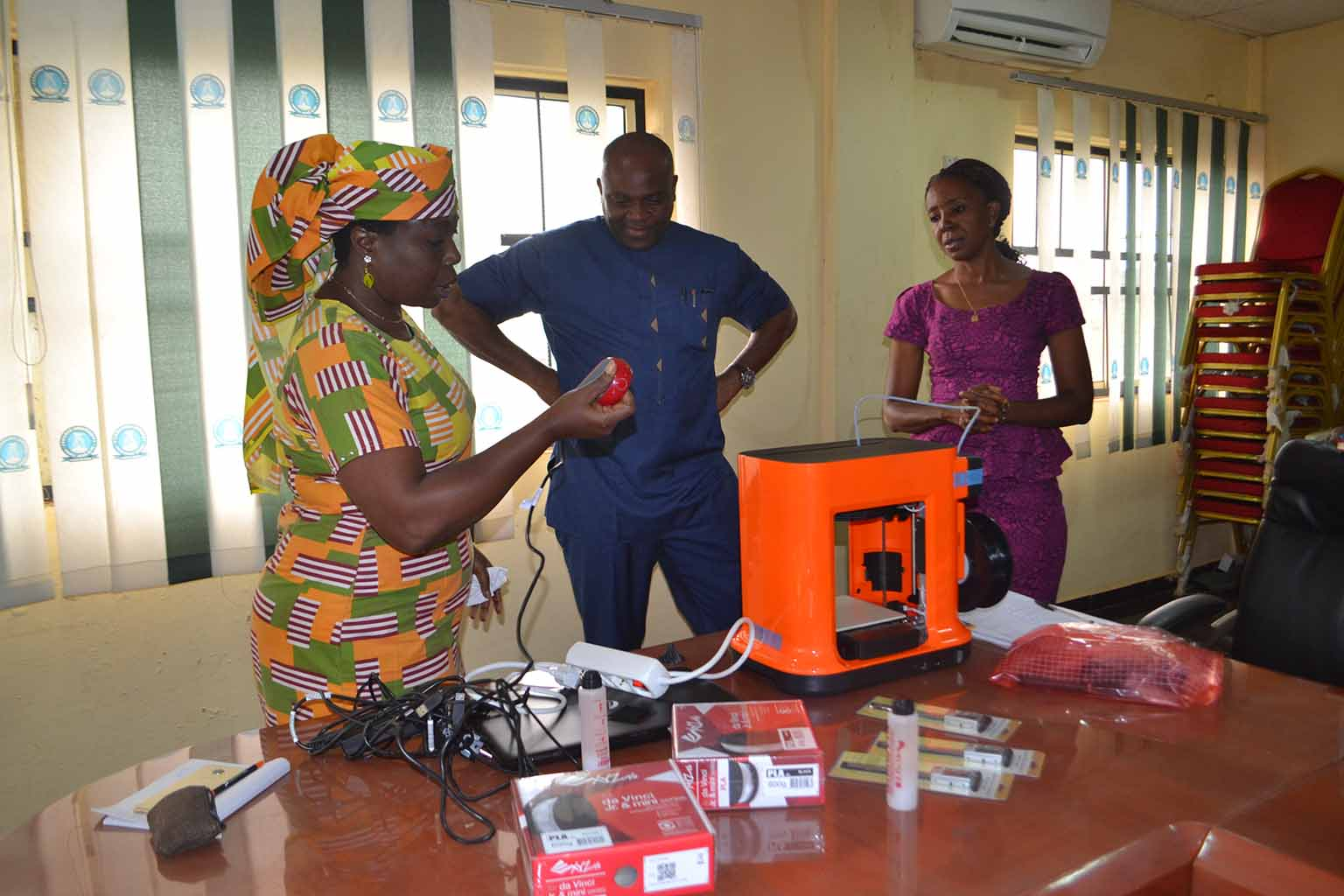 Prof G.M.T Emezue is explaining the functions of the printer to the Vice Chancellor, Prof Chinedu Nwajiuba, while Ms Chiaka Nnodi watches.
