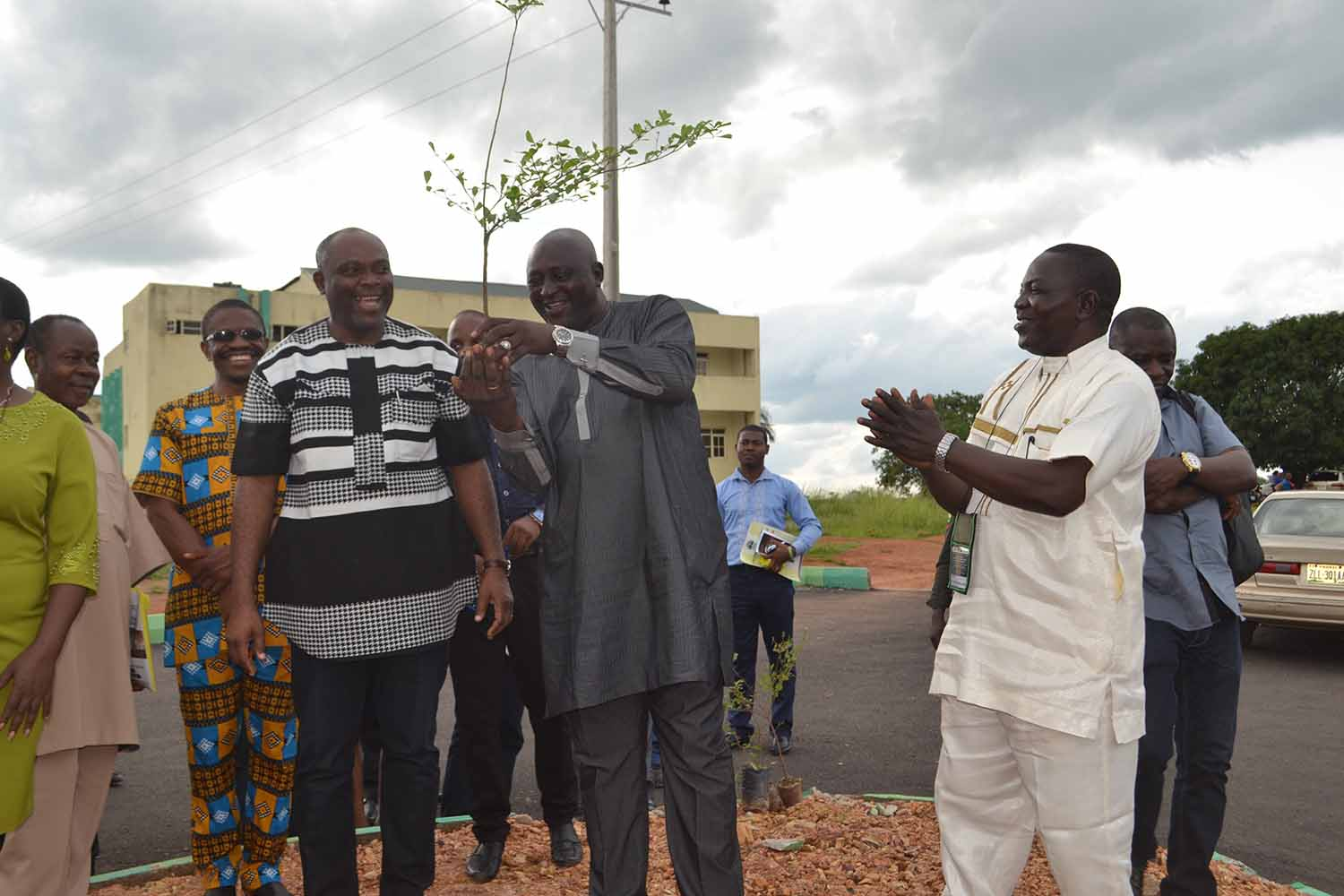 "ANA president, Mallam Denja Abdullahi , plants a tree as part of VC Chinedum Nwajiuba's ""Green Campus Initiative', while the VC and others applaud him"