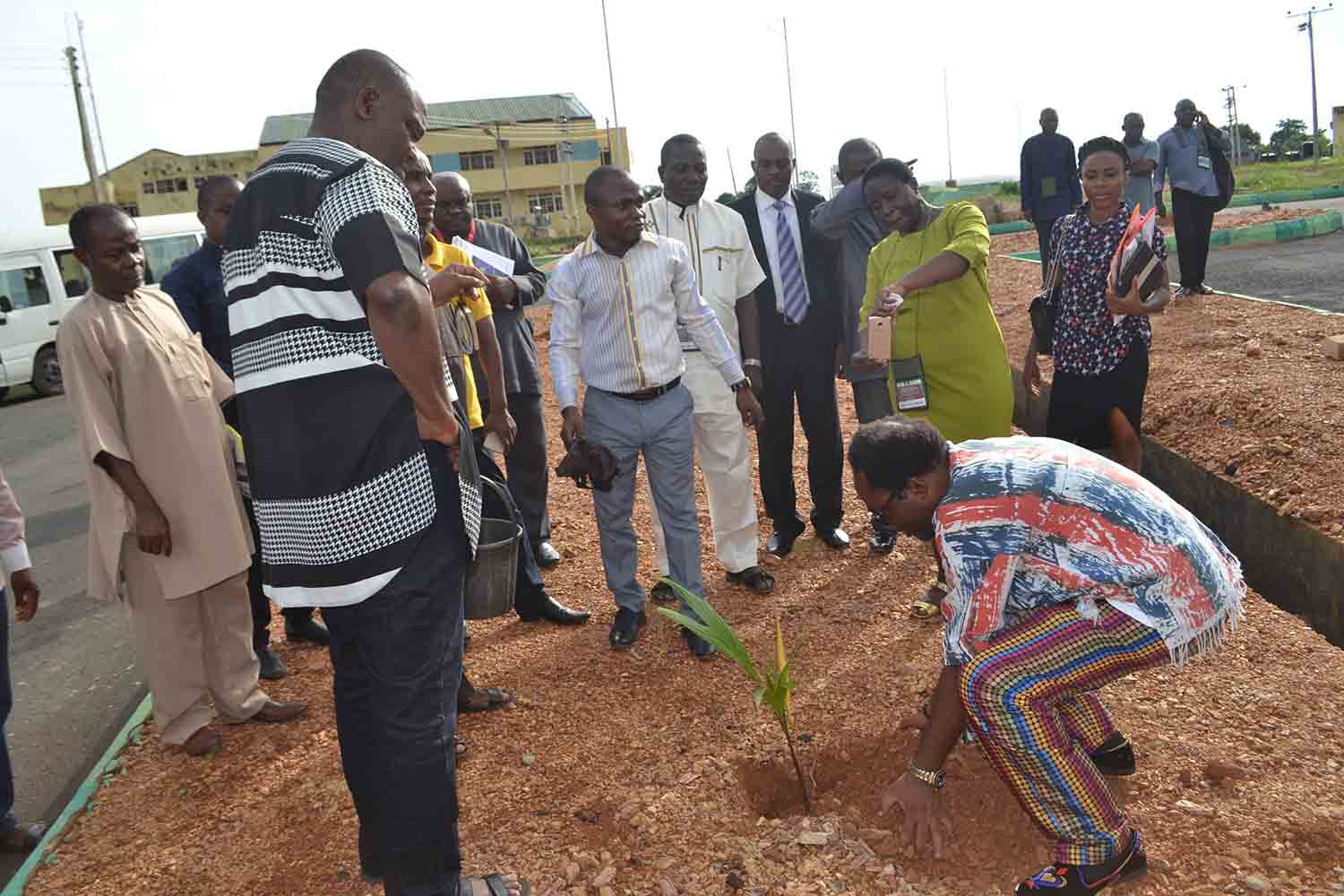 "Mr Ikeogu Oke plants a tree, as part of VC Chinedum Nwajiuba's ""Green Campus Initiative'"