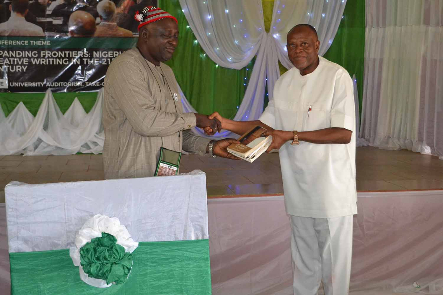 Presentation of books to the University by Mallam Denja Abdullahi, the ANA president. The bag of books was received by the Deputy Vice Chancellor Academic, Prof Sunday Elom