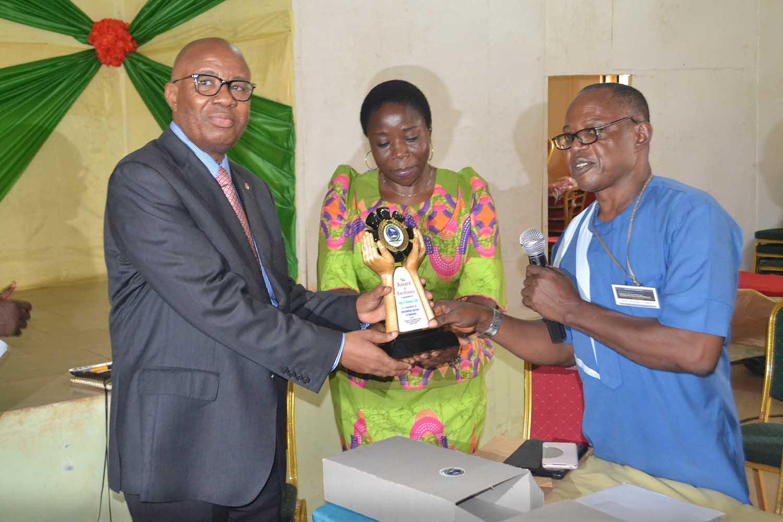 Presentation of award to the Tony Elumelu Foundation. Chief E. Nnorom receives the award on behalf of Tony Elumelu