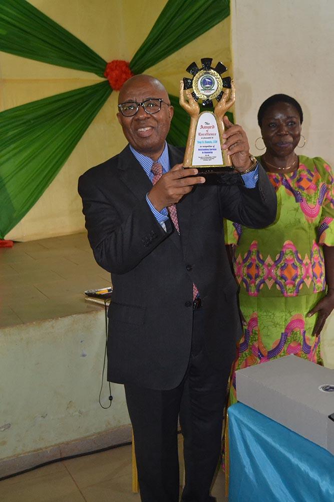 Chief Emmanuel Nnorom displays the award