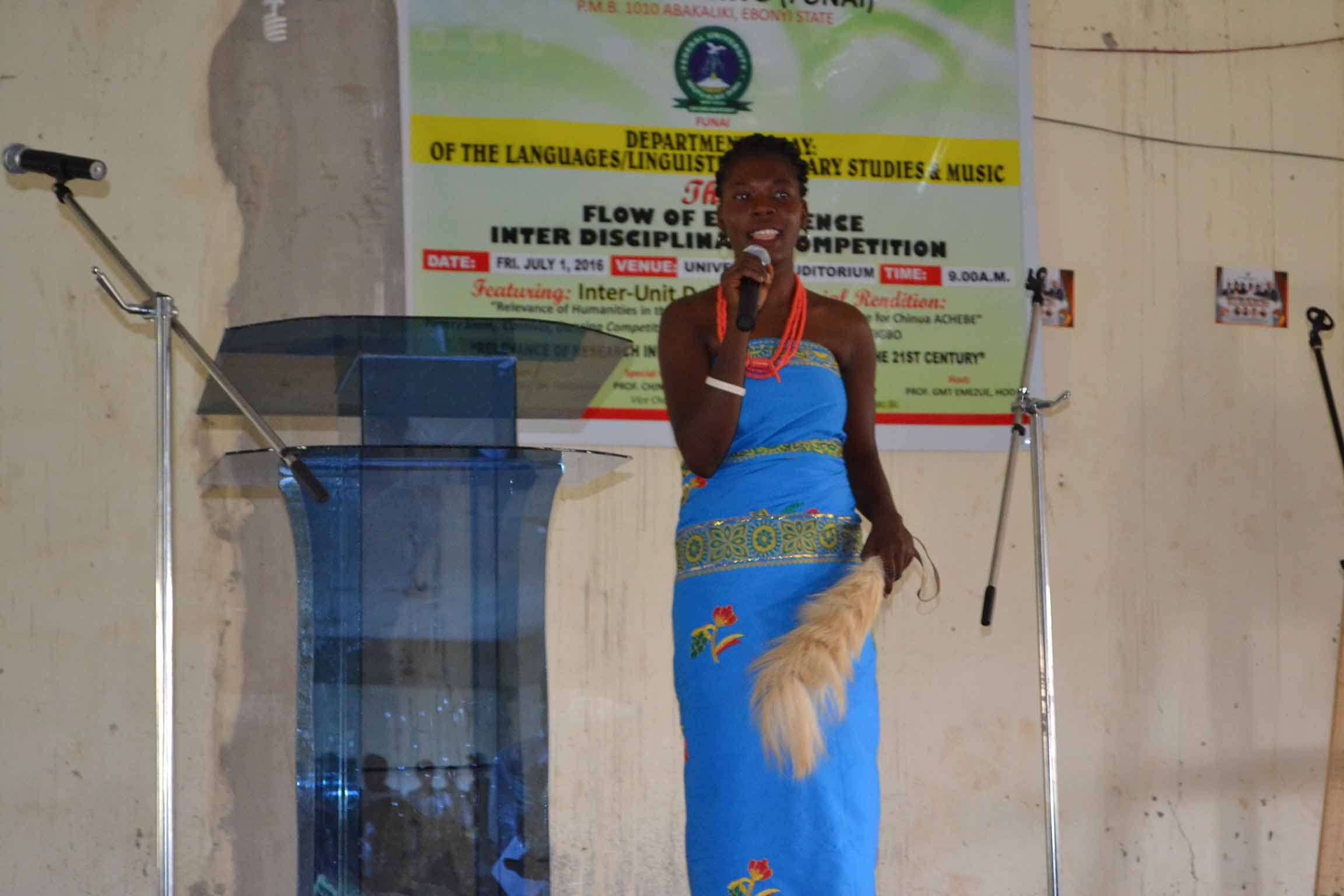 A student giving a poem in Igbo language